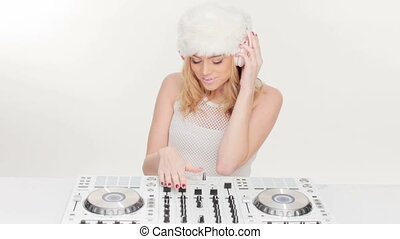 Beautiful young female DJ mixing music