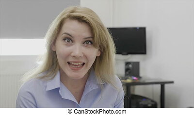 Beautiful young female employee expressing surprise and jaw...