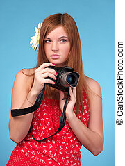 Beautiful young female photographer