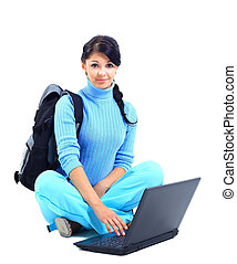 Beautiful young female student with a laptop, isolated on white