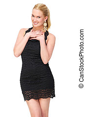 Beautiful young female wearing cute black dress. She is smiling and isolated on white background