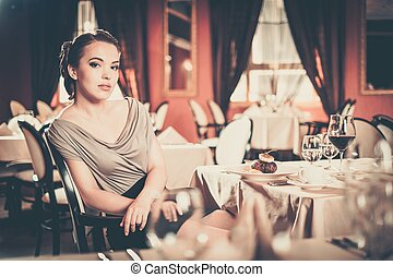 Beautiful young girl alone in a restaurant