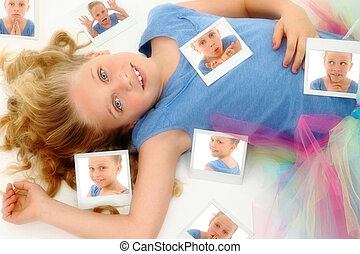 Beautiful Young Girl Child in TuTu on Floor with Photographs