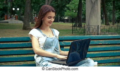 beautiful young girl communicates on a laptop