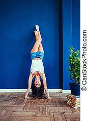 Beautiful young girl doing exercises
