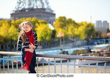 Beautiful young girl enjoying fall day in Paris