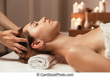 Beautiful young girl having face massage
