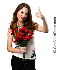Beautiful young girl holding flowers with thumb up