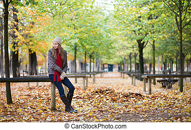 Beautiful young girl in a park on a fall day
