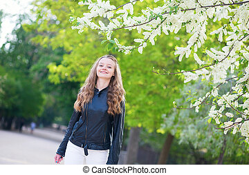 Beautiful young girl in a park on a spring day