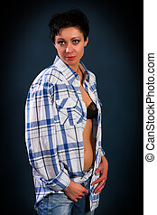 beautiful young girl in a plaid shirt