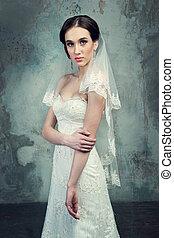 beautiful young girl in a wedding dress