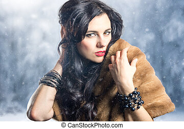Beautiful young girl in fashionable clothes in winter