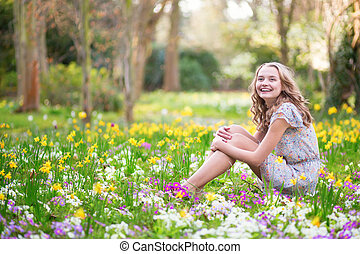 Beautiful young girl in forest on a spring day