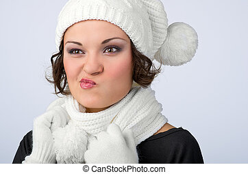 beautiful young girl in her winter warm clothing