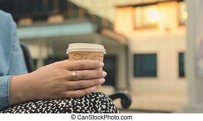 beautiful young girl in outdoor cafe drinking coffee. student. business woman outdoors