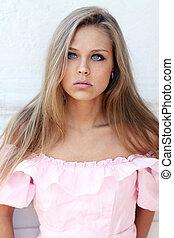 Beautiful young girl in pink dress