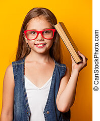 girl in red glasses with book