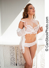 Beautiful young girl in sexy white lingerie