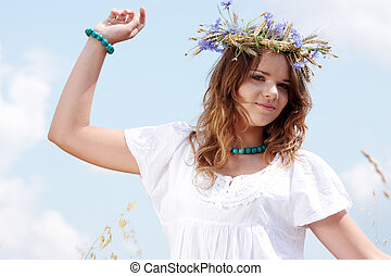 Beautiful young girl in summer field