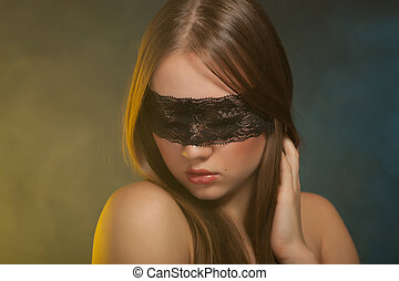 Beautiful young girl in the mask
