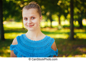 Beautiful young girl in the park