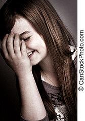 Beautiful young girl laughing