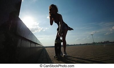 Beautiful young girl lifts the skate with the legs, close up