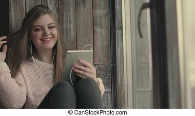 Beautiful young girl Make Online Video Call Using Tablet Computer