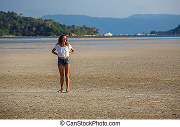 beautiful young girl on the background of a landscape