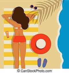Beautiful young girl on the beach in a bikini.