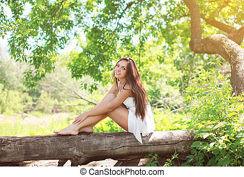 Beautiful young girl on the nature in sunny summer day