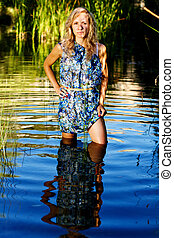 beautiful young girl on the river