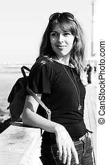 beautiful young girl on the seafront. black and white photography.