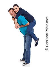 young girl piggybacking on her boyfriend