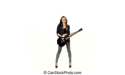 Beautiful young girl playing on electric guitar on a white background.