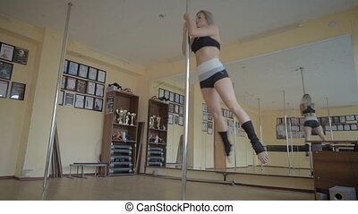 Beautiful young girl Pole dance studio stock footage video