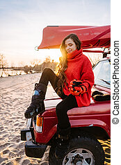 Beautiful young girl posing outdoor on camera