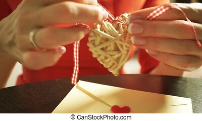 Beautiful young girl preparing a romantic gift for Valentine's day