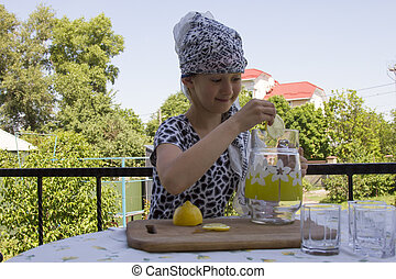 Beautiful young girl preparing lemonade
