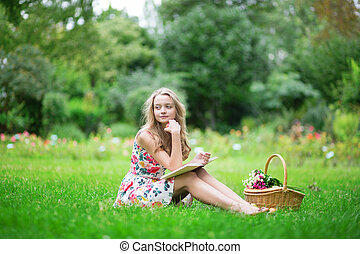 Beautiful young girl reading a book