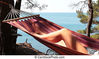 young girl resting in a hammock