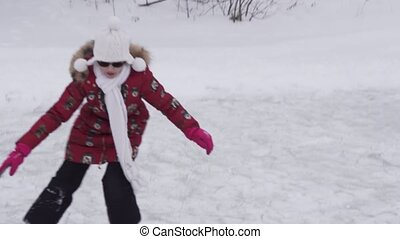 Beautiful young girl riding on figure skates at outdoor rink stock footage video