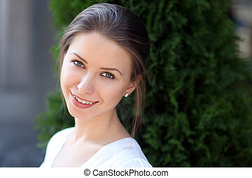 Beautiful young girl smiling