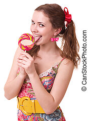 Beautiful young girl with pink spiral lollipops