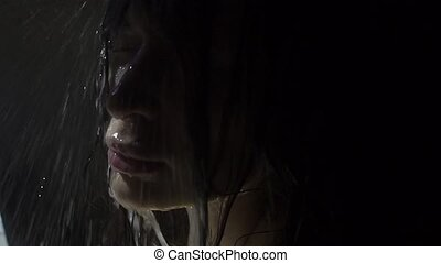 Beautiful young girl taking a shower, slow motion video clip