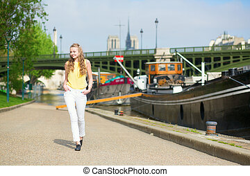 Beautiful young girl walking in Paris