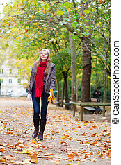 Beautiful young girl walking on a fall day