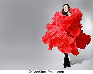 Beautiful young girl wearing red rose dress