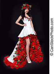 Beautiful young girl wearing red roses dress posing on black background